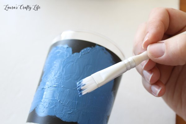Spread paint with a paintbrush