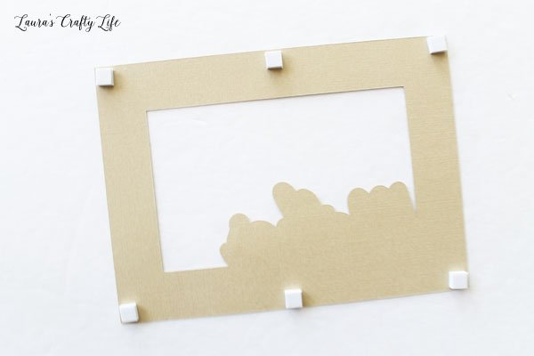 Use adhesive squares to attach card layers