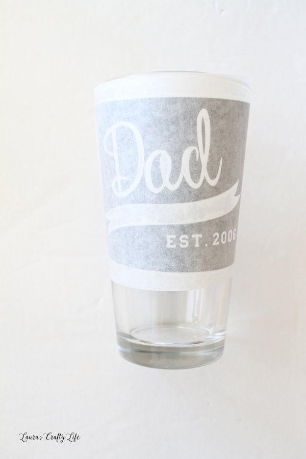 Use transfer tape on pint glass to add vinyl