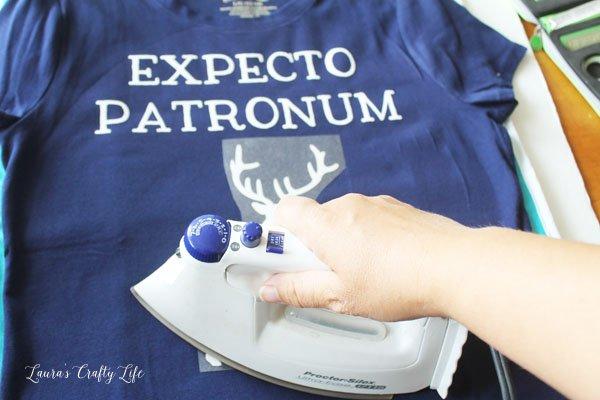 Iron on heat transfer glitter vinyl on shirt
