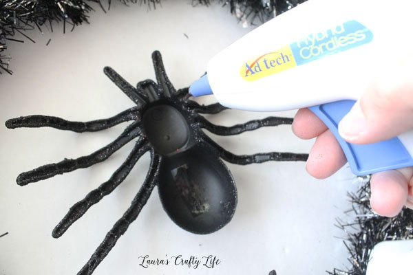 Add spiders to wreath using hot glue
