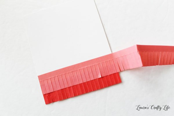 alternate-layers-of-pink-and-red-fringe-tape