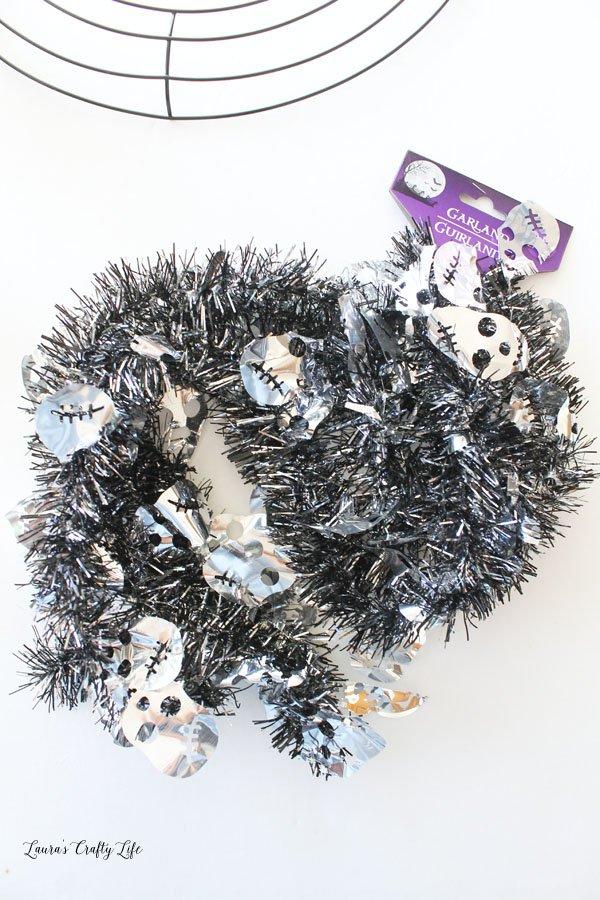Black and silver skull garland from Dollar Tree