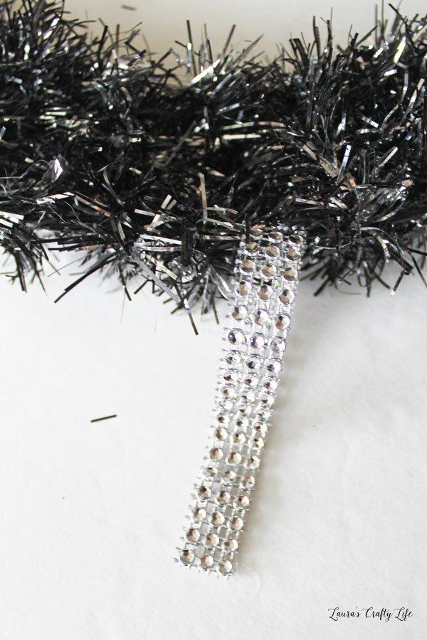 Create a diamond wrap hanger on the wreath