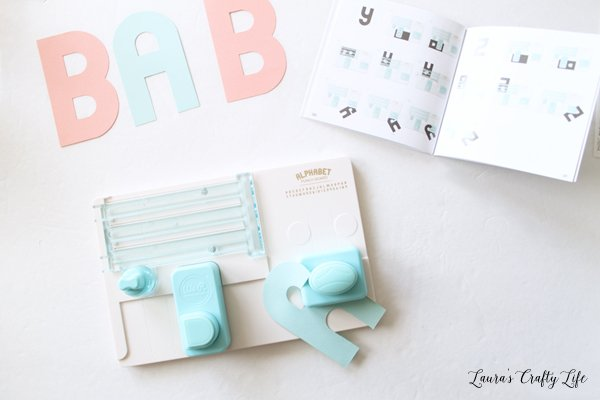 use-alphabet-punch-board-to-cut-out-letters-for-banner