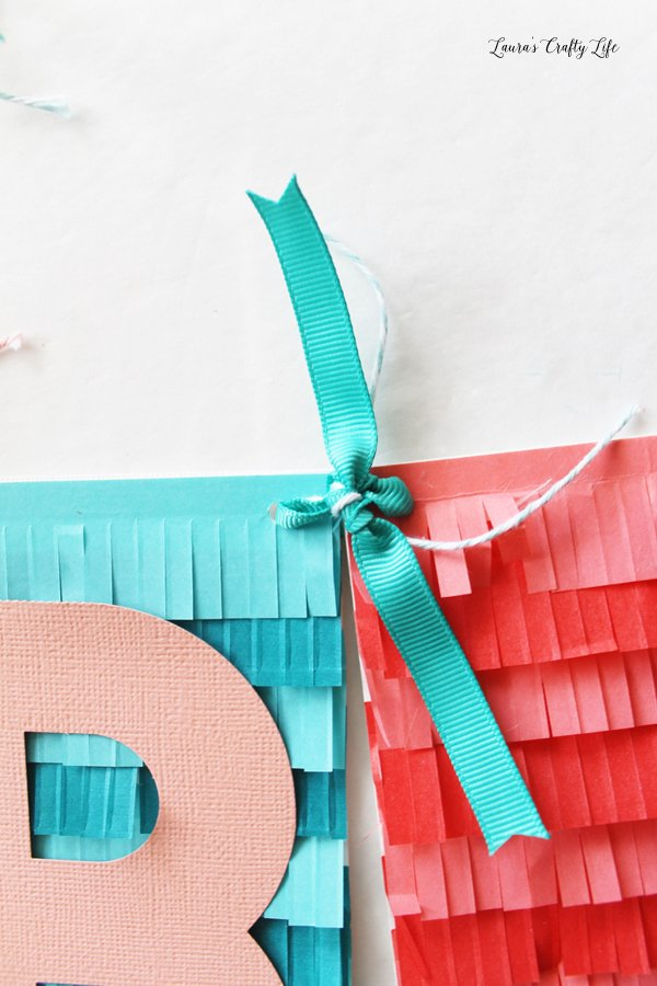 use-ribbon-and-twine-to-tie-the-banner-together