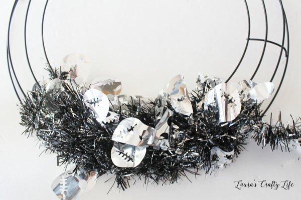 Wrap wreath form with garland