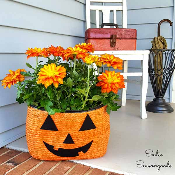 8_orange_black_straw_tote_bag_to_be_repurposed_as_halloween_pumpkin_jack_o-lantern_porch_planter_for_pele_mums_by_sadie_seasongoods