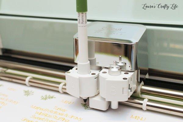 close-up-of-cricut-explore-air-2-machine-writing-with-sour-apple-pen