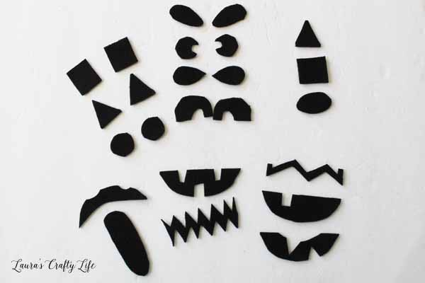 cut-out-jack-o-lantern-faces-from-black-felt