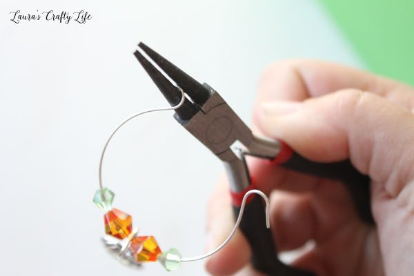 re-bend-the-end-of-the-wine-glass-ring-with-round-nose-pliers