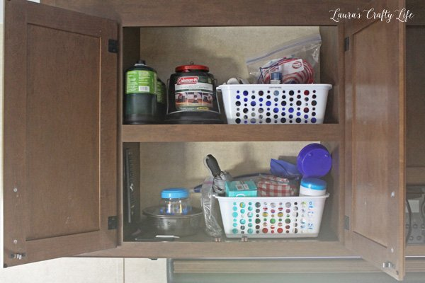 use-plastic-bins-to-keep-items-together-in-cabinets