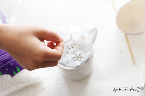 add-glitter-and-snowflakes-to-ball-ornament