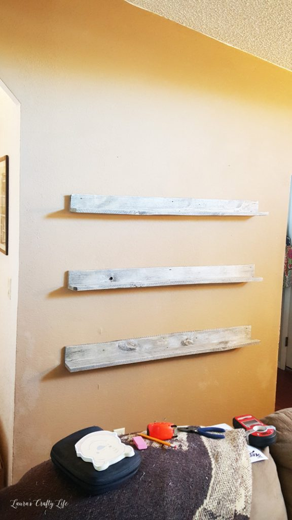 attach-pallet-shelves-to-the-wall-using-the-studs-or-wall-anchors