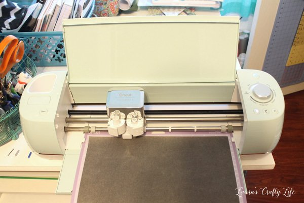 Place faux leather face down on Cricut cutting mat
