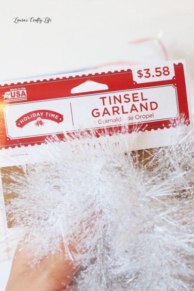 Cut apart tinsel garland to make tails