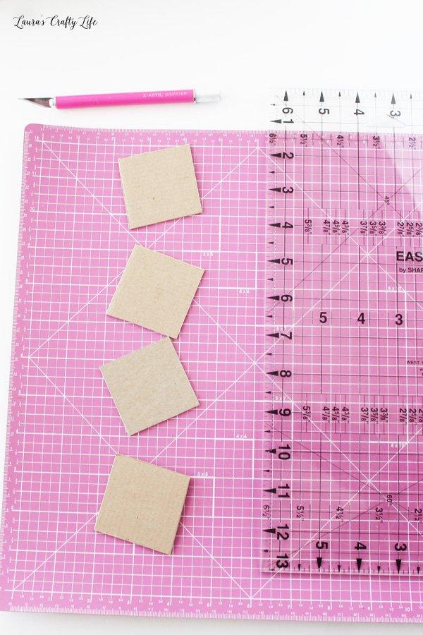 Cut cardboard squares