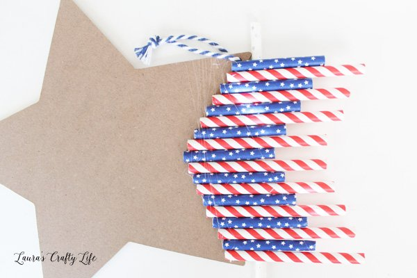 Glue straws to the back of the chalkboard