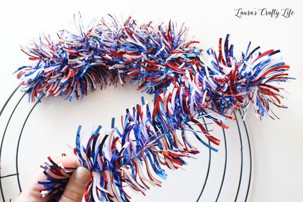 Wrap garland around wreath form
