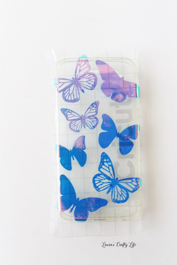 Apply transfer tape and design to phone case