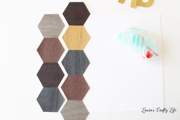 Attach hexagons to white cardstock background