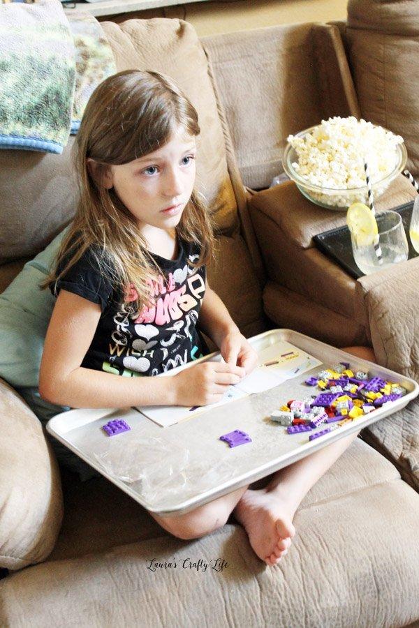 O building her LEGO Brickheadz Batgirl
