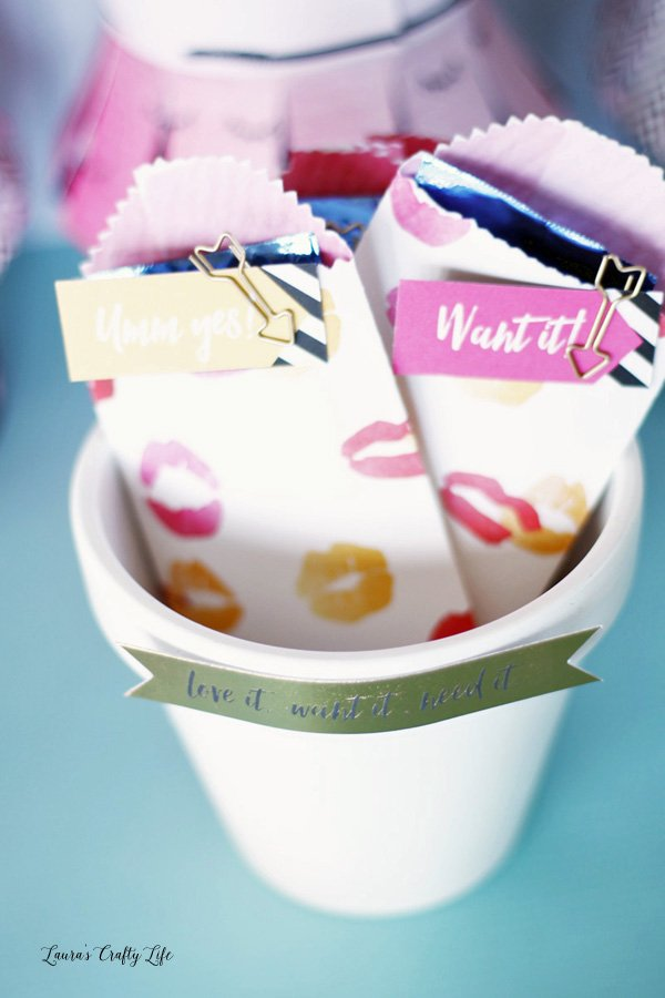 Use painted terra cotta pots to hold small treat bags
