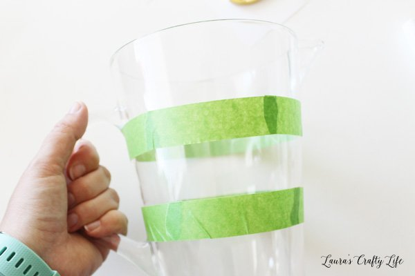 Create a stripe shape around pitcher with painter's tape