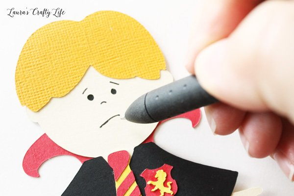 Fill in face details with a pen