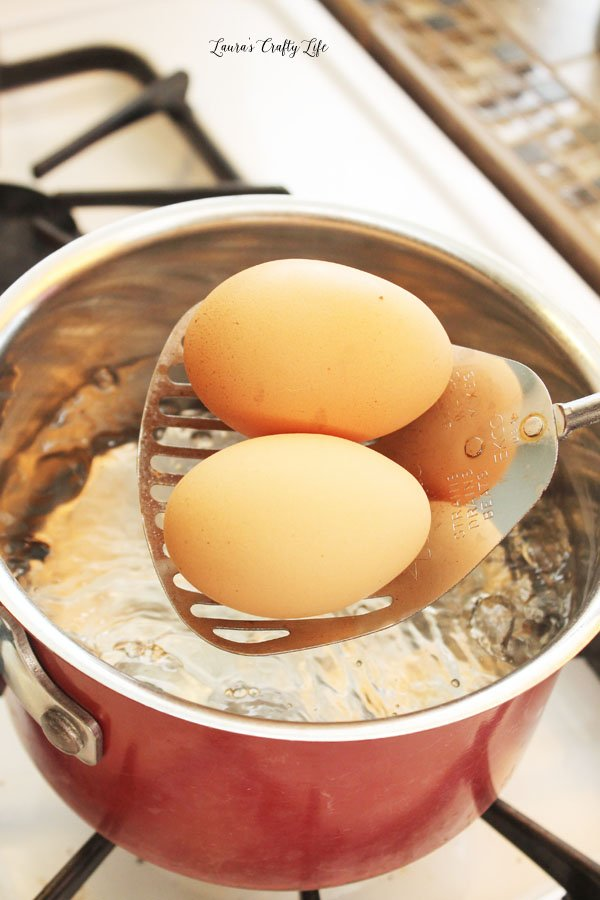 Carefully add eggs to boiling water