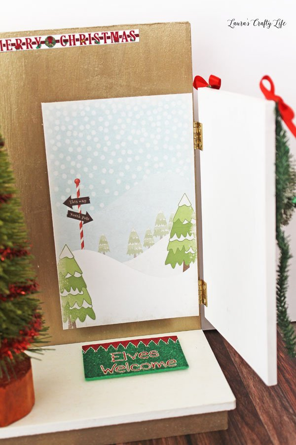 Scene to the North Pole behind Elf on the Shelf door
