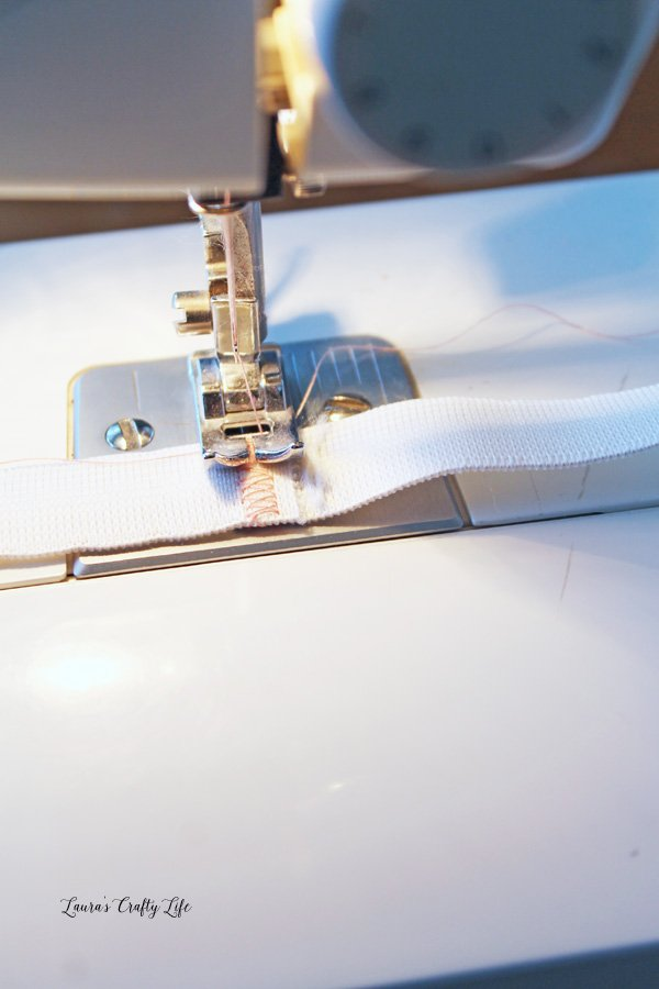 Use sewing machine to stitch elastic together