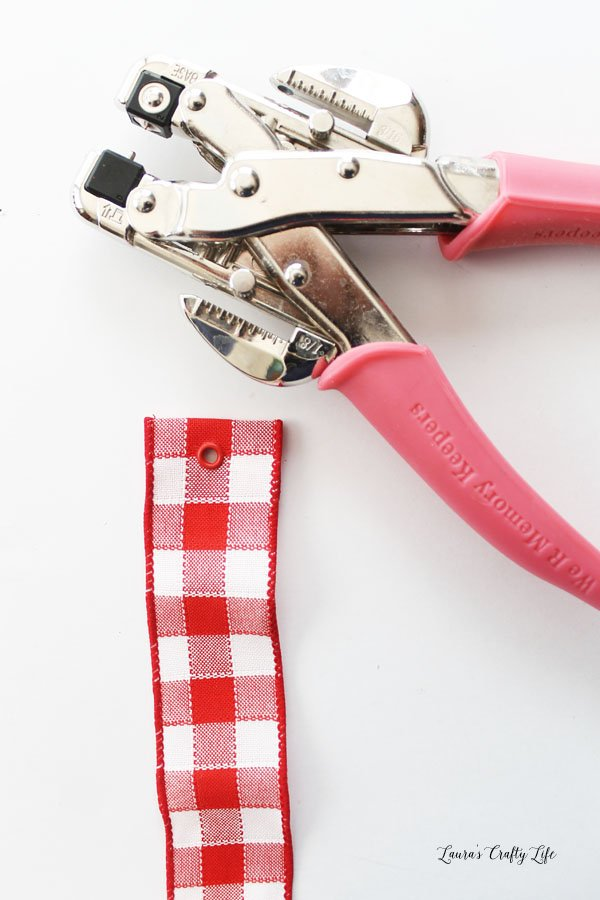 Use Crop-A-Dile to attach eyelet to ribbon