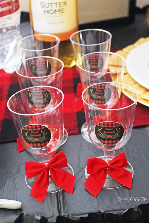 Decorated plastic wine glasses for Buffalo Plaid Cookie Exchange