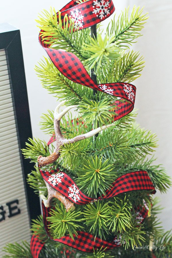 Small antlers on tree for Buffalo Plaid Cookie Exchange
