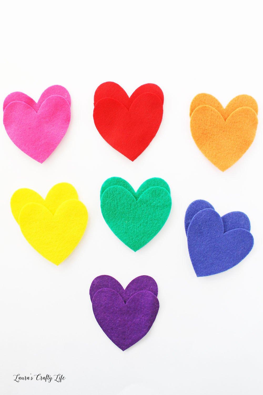 Cut out rainbow hearts from felt
