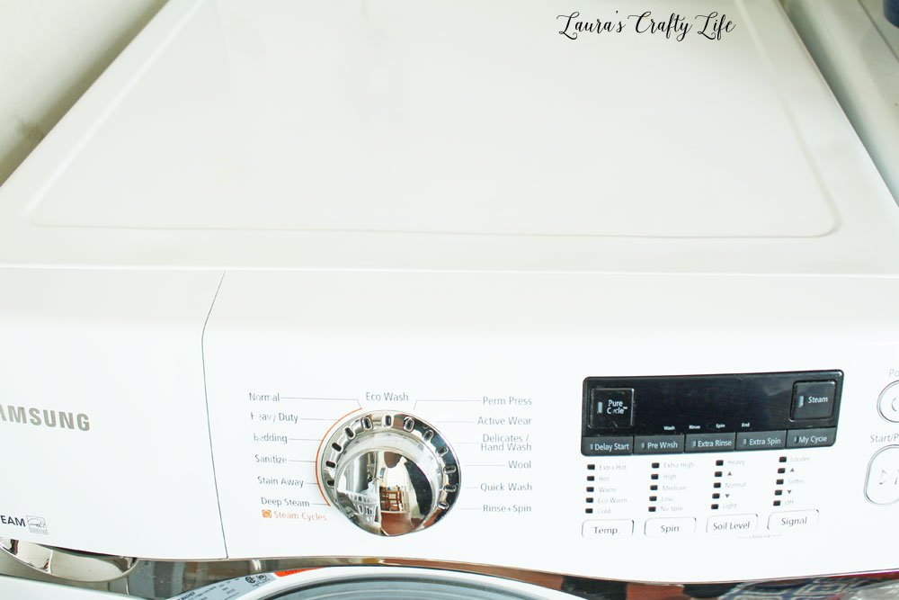 Clean top and sides of front load washer