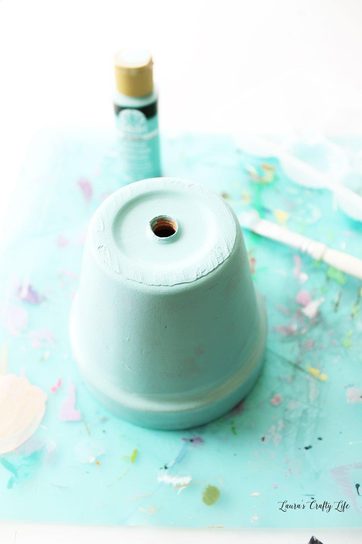 Painted clay pot with Dutch Aqua FolkArt