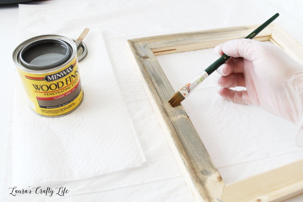 Apply paint or stain to unfinished frame