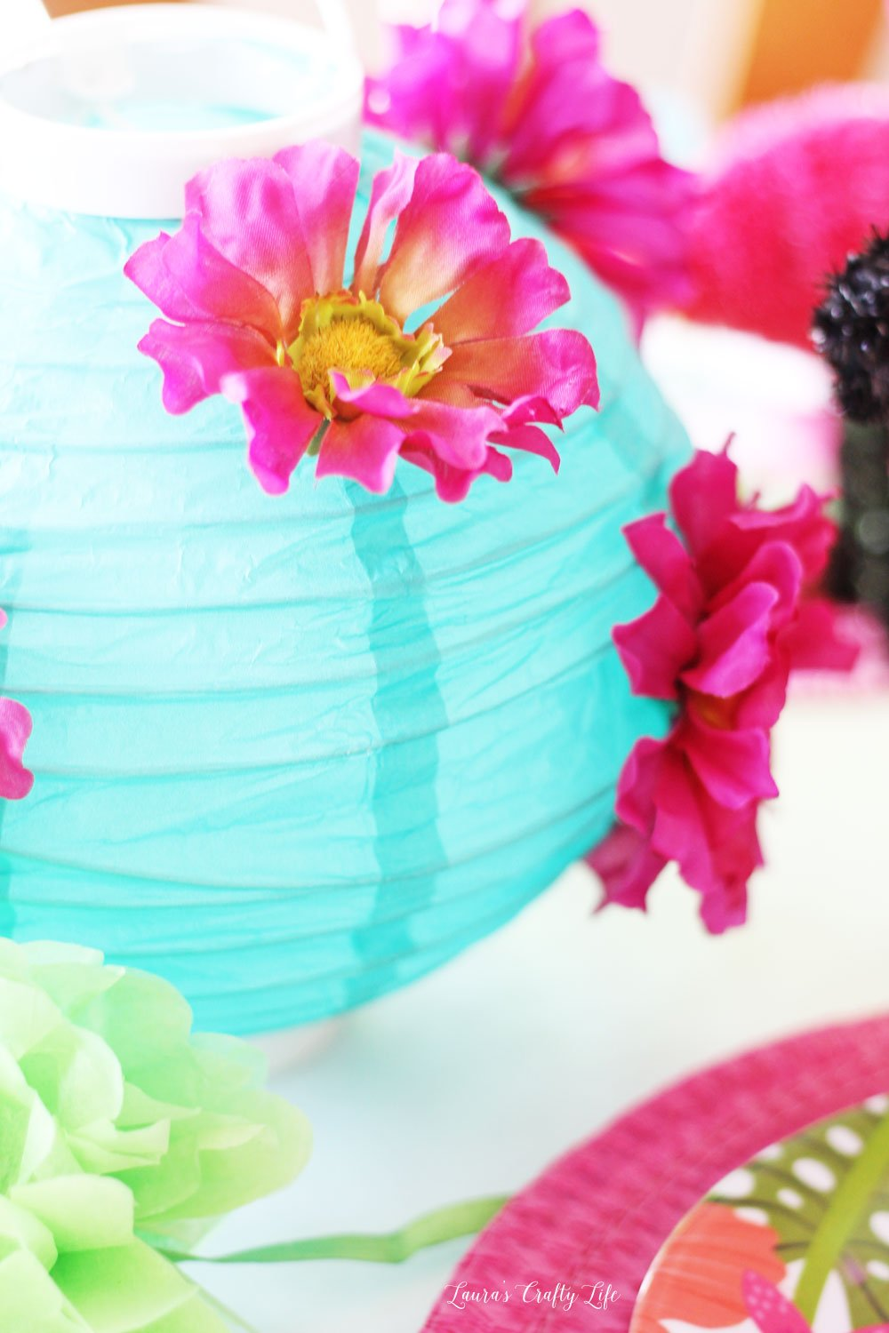 Paper lantern with fabric flowers