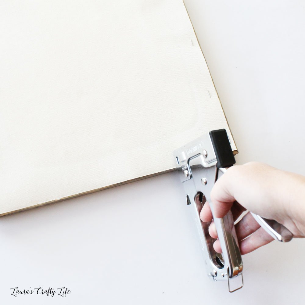 Use staple gun to reattach canvas