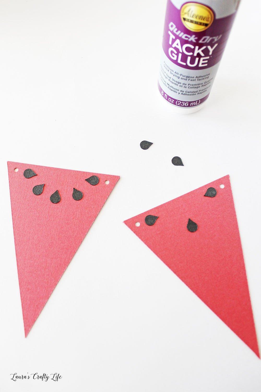 Glue watermelon seeds to banner