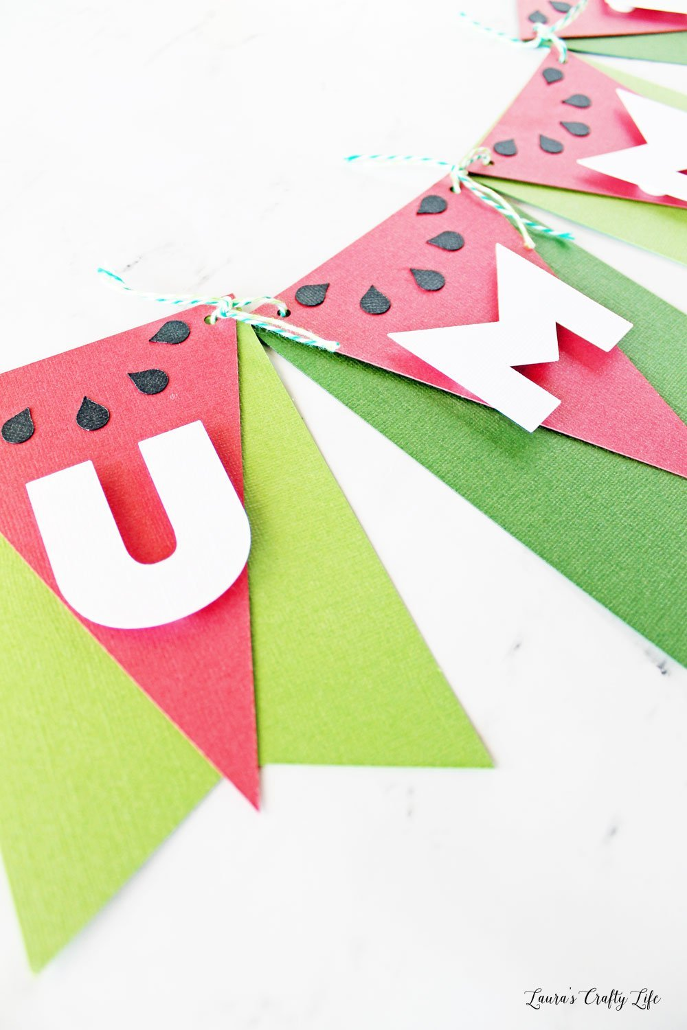 Use adhesive foam dots to attach letters to banner