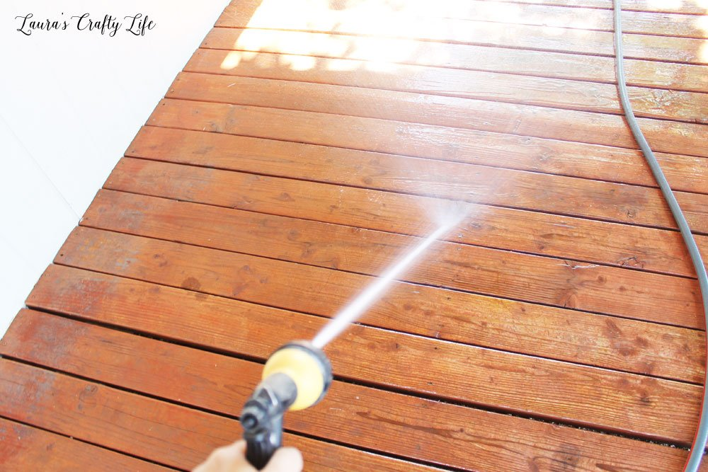 Use garden hose or pressure washer to spray off the cleaner