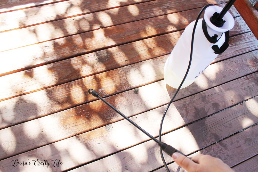Use garden sprayer to apply cleaner to deck surfaces