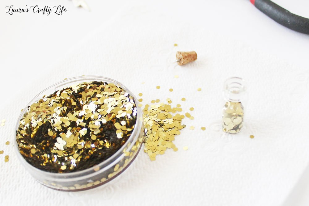 Add gold glitter to potion bottle