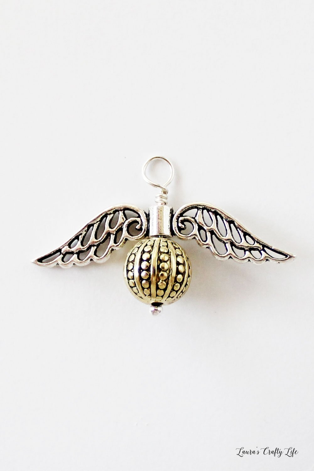 How to create a wire wrapped golden snitch charm #harrypotter #jewelry #charm #laurascraftylife