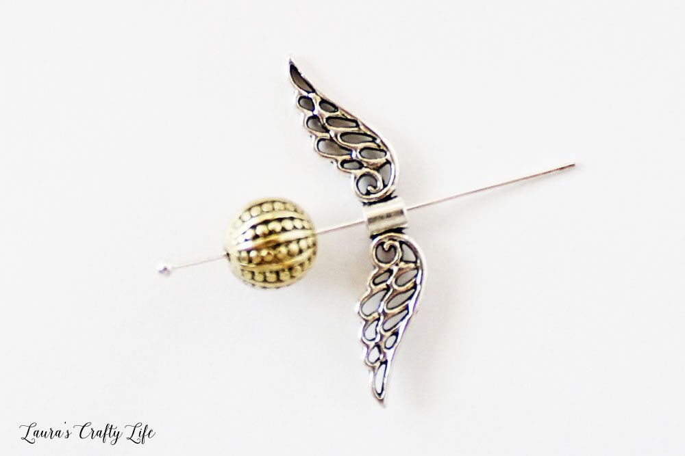 Thread gold bead and wings on headpin