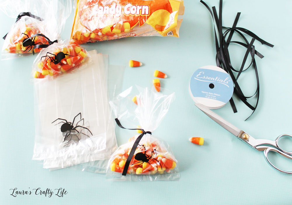 Fill spider treat bags and tie with ribbon