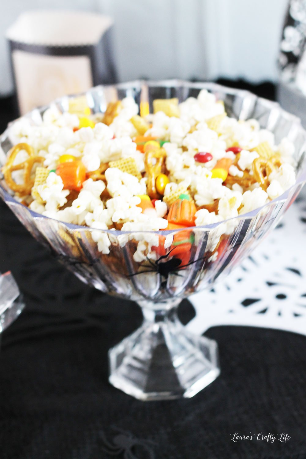 Halloween snack mix in a spider serving bowl for Halloween party
